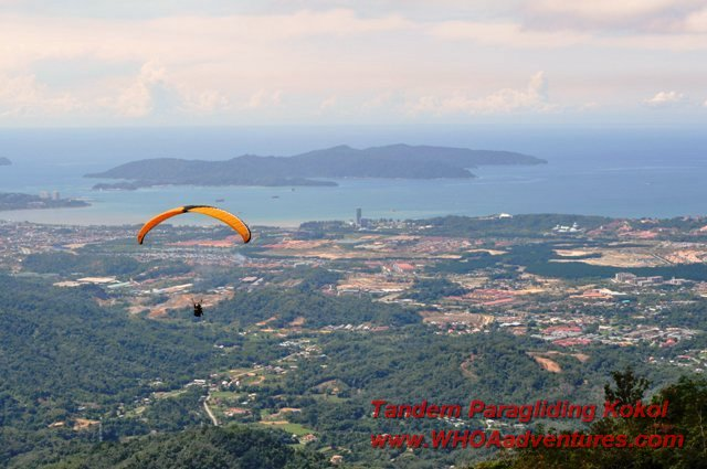 Paragliding over Menggatal with Kota Kinabalu City in a distance