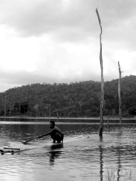 A Temiar bamboo rafting on Temenggor Lake